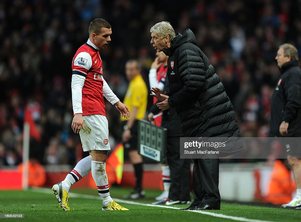 Arsenal manager Arsene Wenger talks to <a gi-track='captionPersonalityLinkClicked' href=/galleries/search?phrase=Lukas+Podolski&family=editorial&specificpeople=204460 ng-click='$event.stopPropagation()'>Lukas Podolski</a> during the Barclays Premier League match between Arsenal and Stoke City at Emirates Stadium on February 02, 2013 in London, England.
