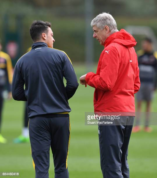 Arsenal manager Arsene Wenger talks to Mesut Ozil before a training session at London Colney on March 17 2017 in St Albans England