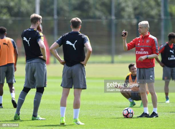 Arsenal manager Arsene Wenger talks to Per Mertesacker and Rob Holding during a training session at London Colney on May 24 2017 in St Albans England