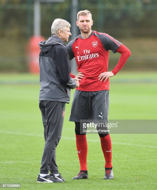 Arsenal manager Arsene Wenger talks to Per Mertesacker during a training session at London Colney on November 21 2017 in St Albans England