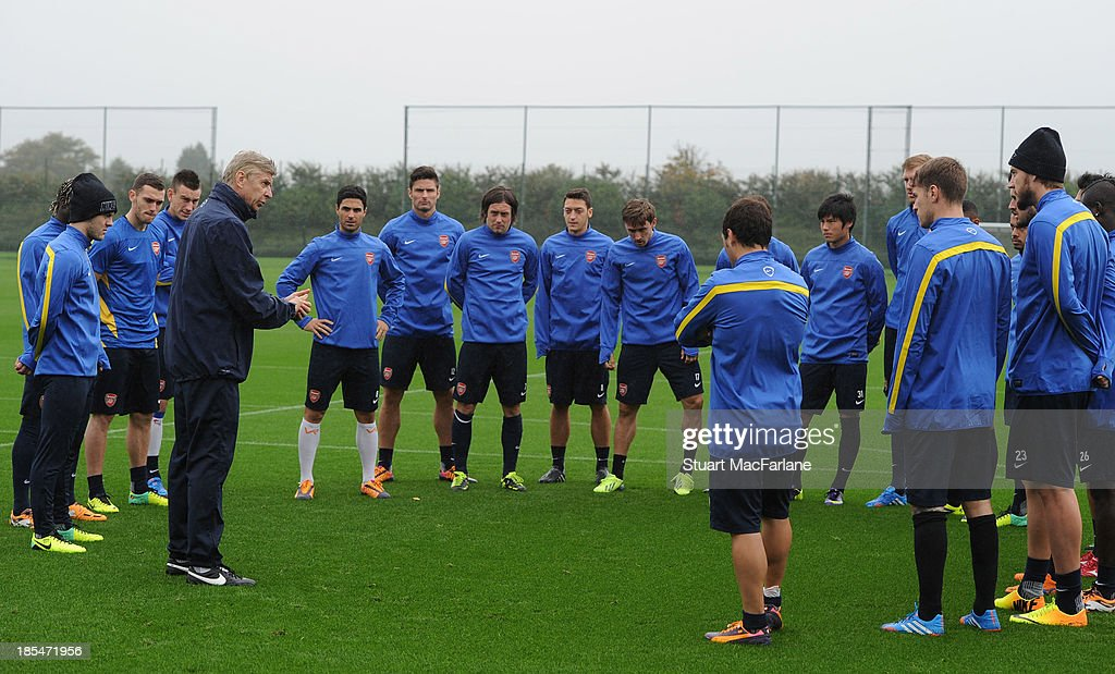 Arsenal manager Arsene Wenger talks to the squad before a training session at London Colney on October 21, 2013 in St Albans, England.