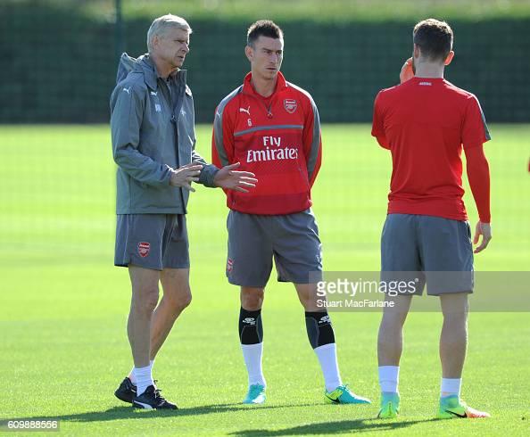 Arsenal manager Arsene Wenger talks with defenders Laurent Koscielny and Shkodran Mustafi during a training session at London Colney on September 23...