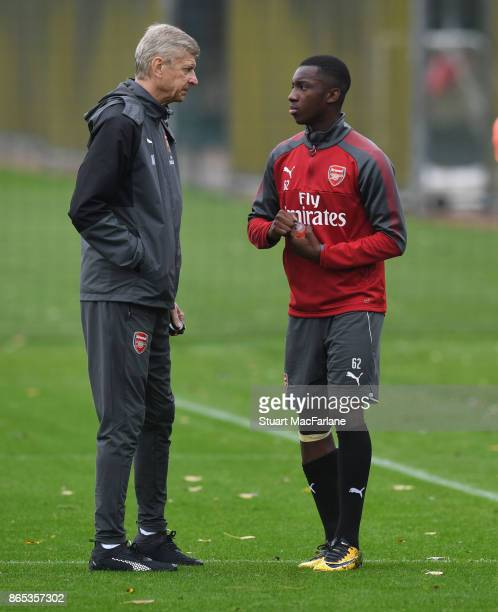 Arsenal manager Arsene Wenger talks with Eddie Nketiah during a training session at London Colney on October 23 2017 in St Albans England