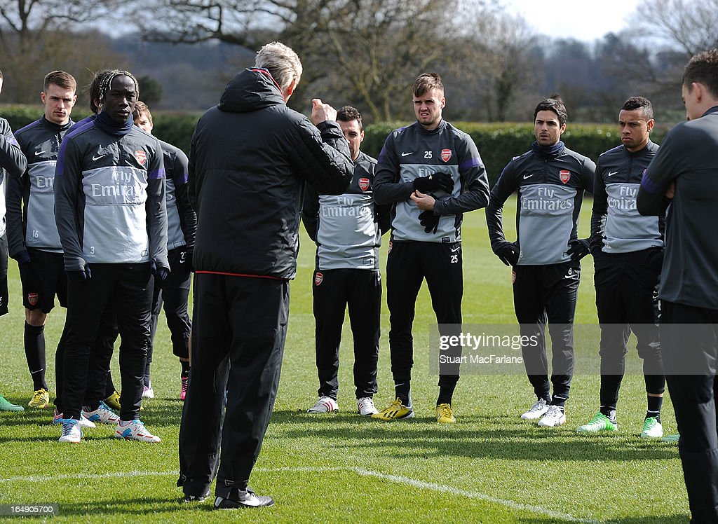 Arsenal manager Arsene Wenger talks with his players (L-R) Aaron Ramsey, Bacary Sagna, Santi Cazorla, Carl Jenkinson, Mikel Arteta and Francis Coquelin a training session at London Colney on March 29, 2013 in St Albans, England.