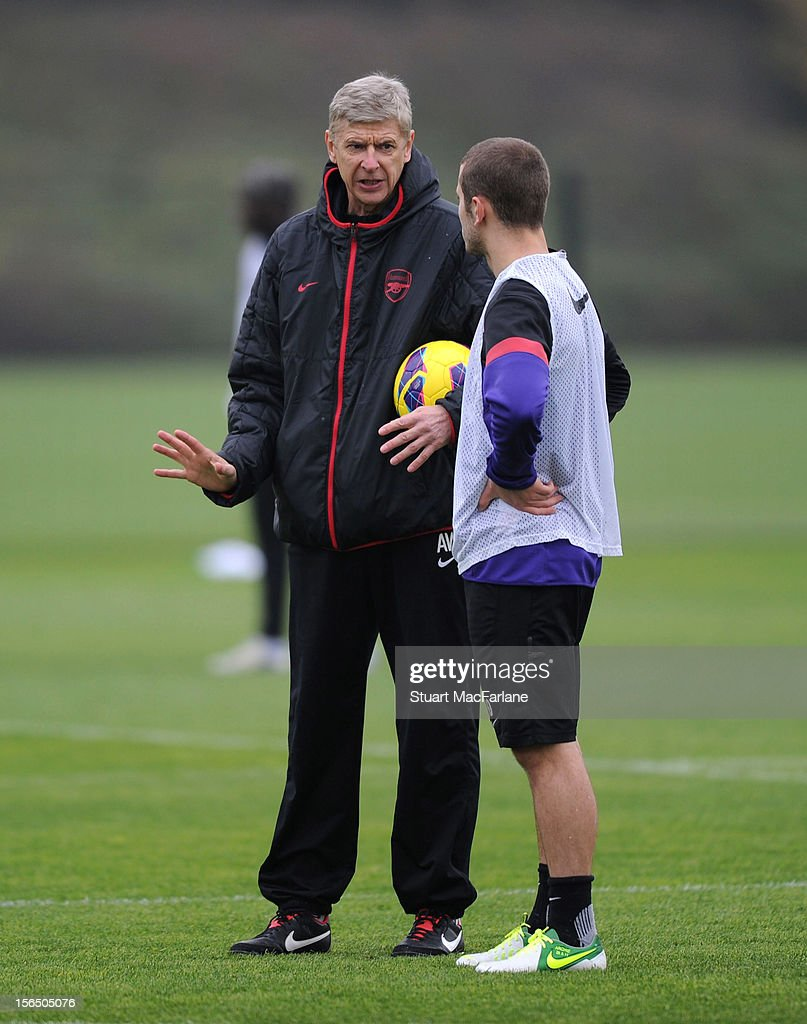 Arsenal manager <a gi-track='captionPersonalityLinkClicked' href=/galleries/search?phrase=Arsene+Wenger&family=editorial&specificpeople=171184 ng-click='$event.stopPropagation()'>Arsene Wenger</a> talks with <a gi-track='captionPersonalityLinkClicked' href=/galleries/search?phrase=Jack+Wilshere&family=editorial&specificpeople=5446655 ng-click='$event.stopPropagation()'>Jack Wilshere</a> during a training session at London Colney on November 16, 2012 in St Albans, England.