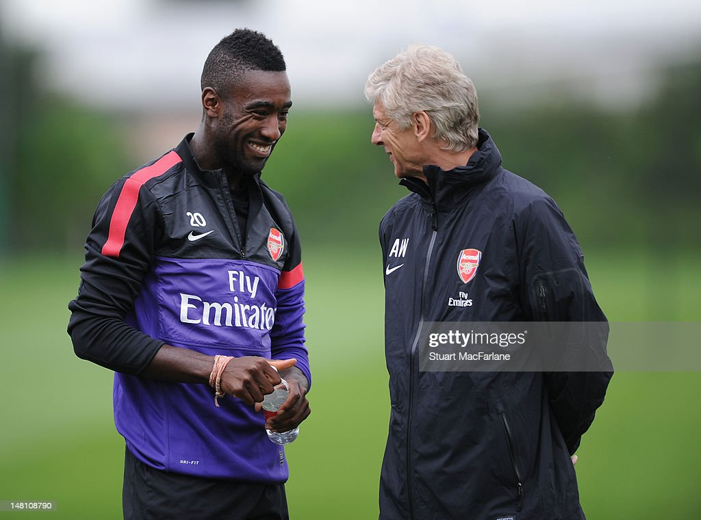 Arsenal manager Arsene Wenger talks with Johan Djourou during a training session at London Colney on July 10, 2012 in St Albans, England.