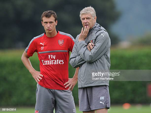 Arsenal manager Arsene Wenger talks with Krystian Bielik during a training session at London Colney on August 19 2016 in St Albans England