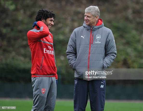 Arsenal manager Arsene Wenger talks with Mohamed Elneny during a training session at London Colney on December 2 2016 in St Albans England