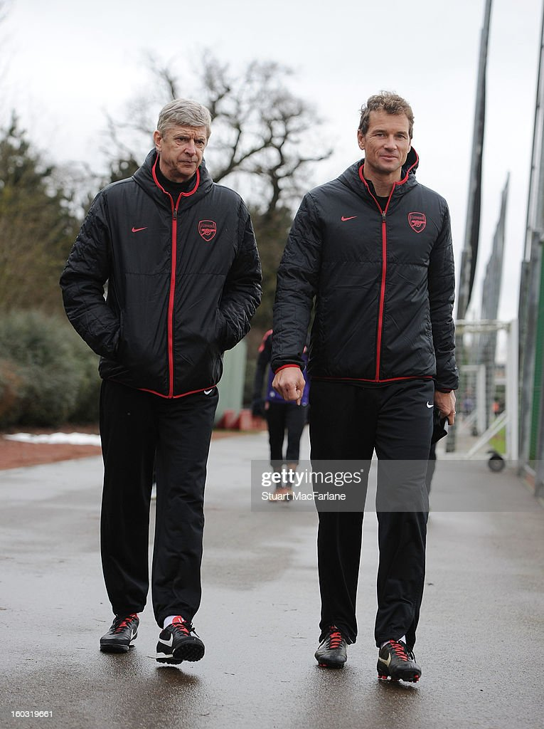 Arsenal manager <a gi-track='captionPersonalityLinkClicked' href=/galleries/search?phrase=Arsene+Wenger&family=editorial&specificpeople=171184 ng-click='$event.stopPropagation()'>Arsene Wenger</a> walks alongside ex-player Jens Lehmann before a training session at London Colney on January 29, 2013 in St Albans, England.