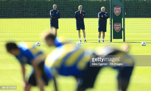 Arsenal manager Arsene Wenger watches his players during a training session at London Colney St Albans