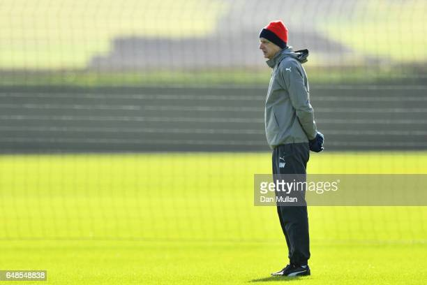 Arsenal manager Arsene Wenger watches over his players during the Arsenal training session at London Colney on March 6 2017 in St Albans England