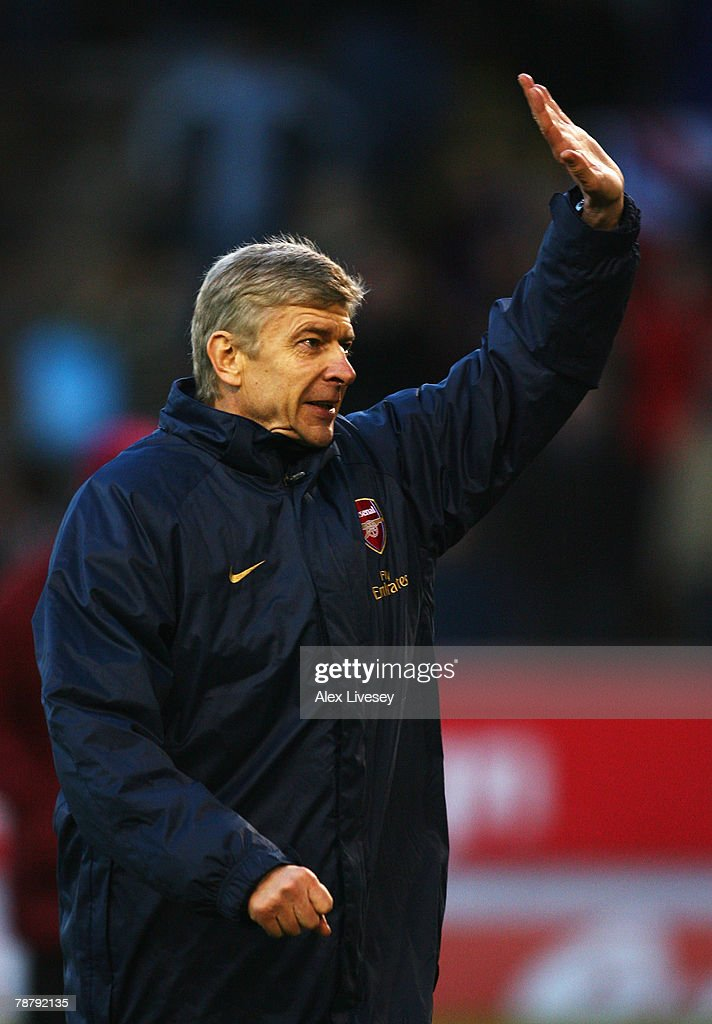 Arsenal Manager Arsene Wenger waves to the crowd after his team's victory during the FA Cup sponsored by E.ON Third Round match between Burnley and Arsenal at Turf Moor on January 6, 2008 in Burnley, England.
