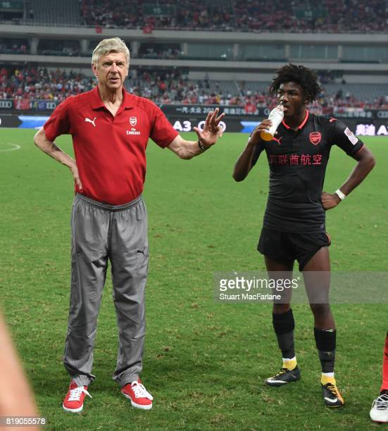 Arsenal manager Arsene Wenger with Ainsley MaitlandNiles during a pre season friendly between Bayern Munich and Arsenal at Shanghai Stadium on July...
