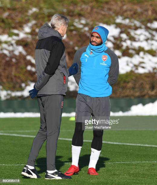 Arsenal manager Arsene Wenger with Alex Lacazette during a training session at London Colney on December 12 2017 in St Albans England