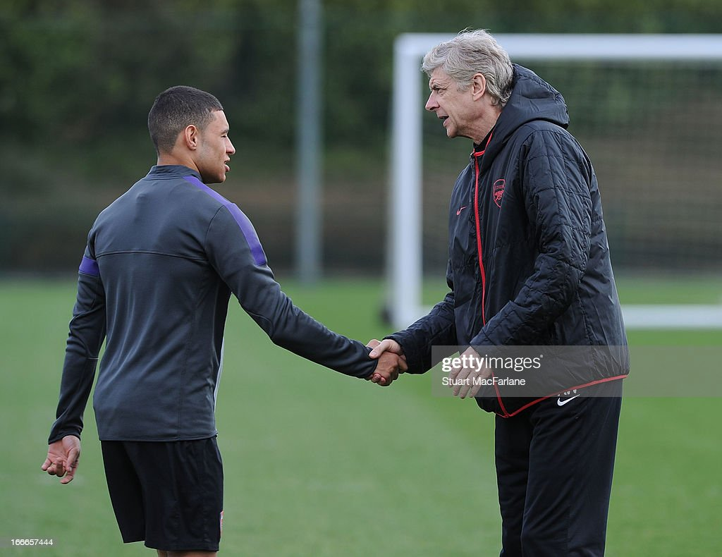 Arsenal manager <a gi-track='captionPersonalityLinkClicked' href=/galleries/search?phrase=Arsene+Wenger&family=editorial&specificpeople=171184 ng-click='$event.stopPropagation()'>Arsene Wenger</a> with <a gi-track='captionPersonalityLinkClicked' href=/galleries/search?phrase=Alex+Oxlade-Chamberlain&family=editorial&specificpeople=7191518 ng-click='$event.stopPropagation()'>Alex Oxlade-Chamberlain</a> before a training session at London Colney on April 15, 2013 in St Albans, England.