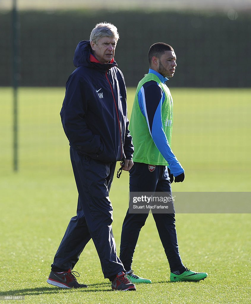 Arsenal manager Arsene Wenger with Alex Oxlade-Chamberlain during a training session at London Colney on January 27, 2014 in St Albans, England.
