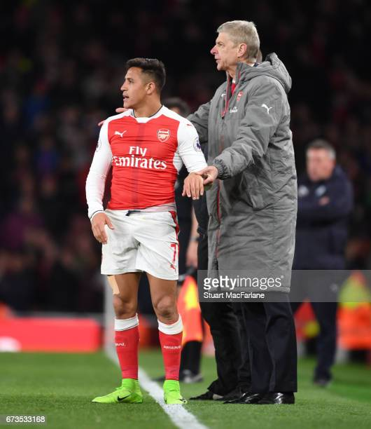 Arsenal manager Arsene Wenger with Alexis Sanchez during the Premier League match between Arsenal and Leicester City at Emirates Stadium on April 26...