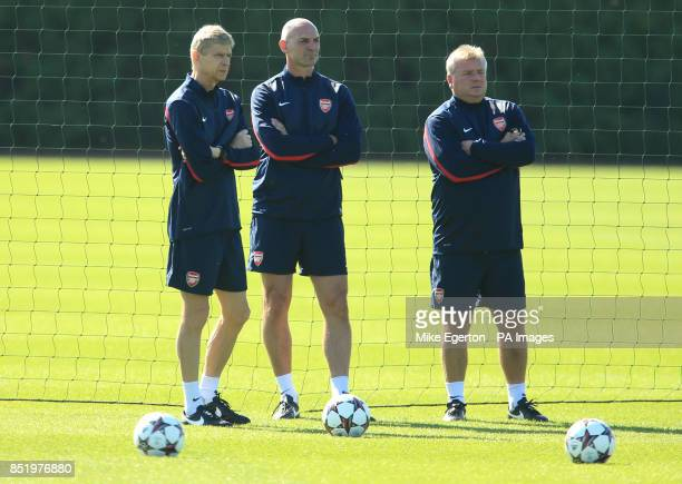 Arsenal manager Arsene Wenger with assistant Steve Bould and first team coach Neil Banfield during a training session at London Colney St Albans