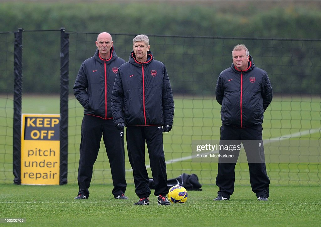 Arsenal manager Arsene Wenger with (L) assistant Steve Bould and (R) Neil Banfield during a training session at London Colney on November 16, 2012 in St Albans, England.