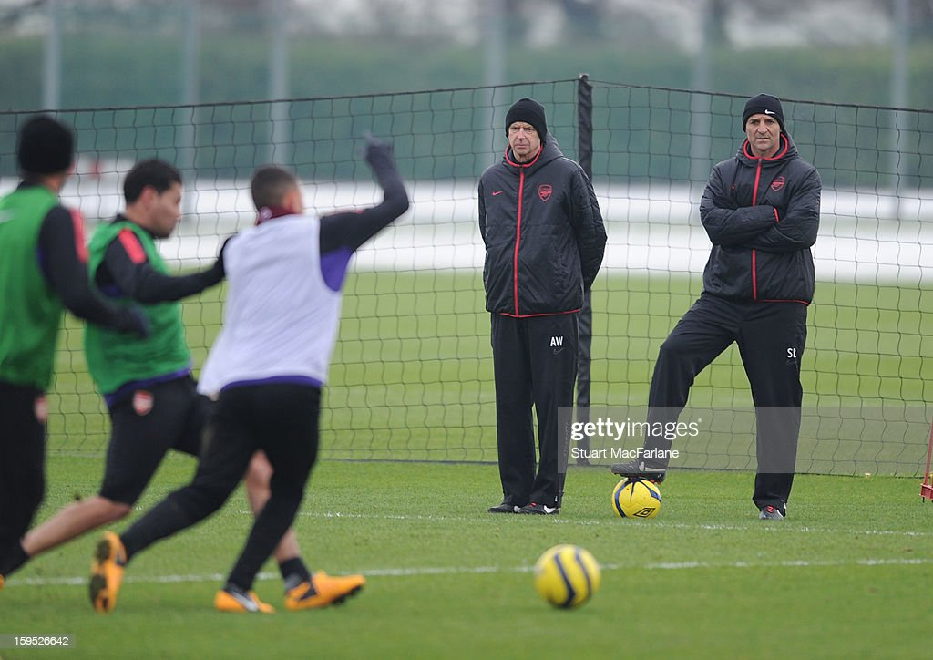 Arsenal manager <a gi-track='captionPersonalityLinkClicked' href=/galleries/search?phrase=Arsene+Wenger&family=editorial&specificpeople=171184 ng-click='$event.stopPropagation()'>Arsene Wenger</a> with assistant Steve Bould during a training session at London Colney on January 15, 2013 in St Albans, England.
