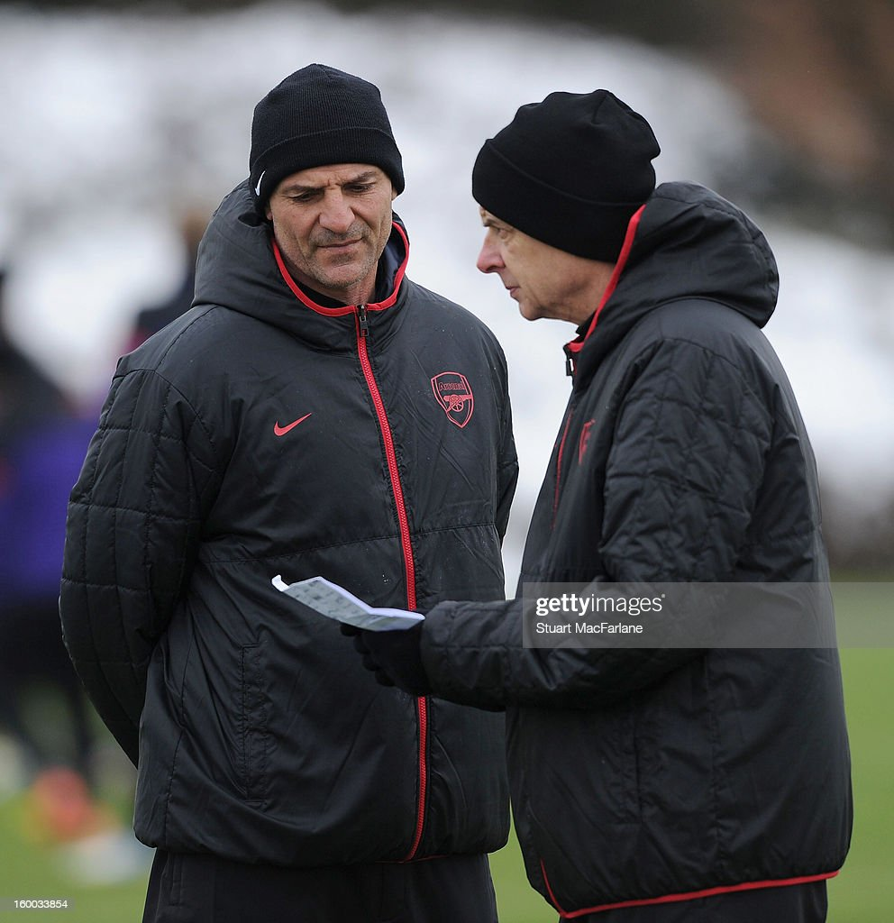 Arsenal manager Arsene Wenger with assistant Steve Bould during a training session at London Colney on January 25, 2013 in St Albans, England.