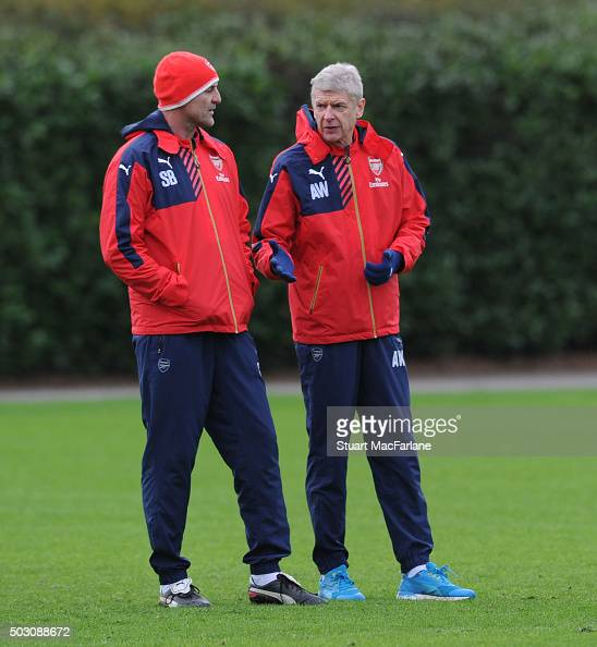 Arsenal manager Arsene Wenger with assistant Steve Bould during a training session at London Colney on January 1 2016 in St Albans England