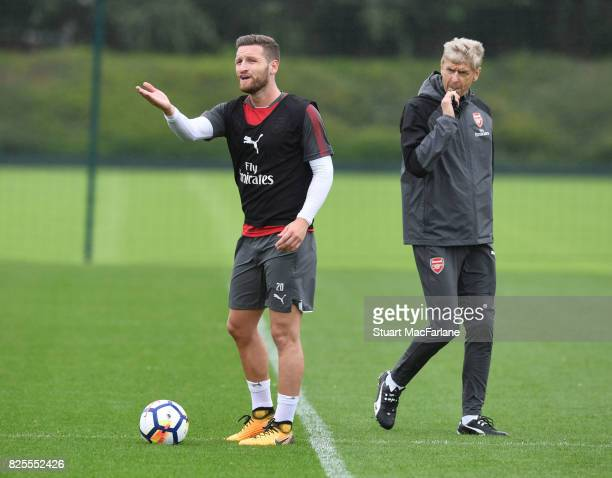 Arsenal manager Arsene Wenger with defender Shkodran Mustafi during a training session at London Colney on August 2 2017 in St Albans England