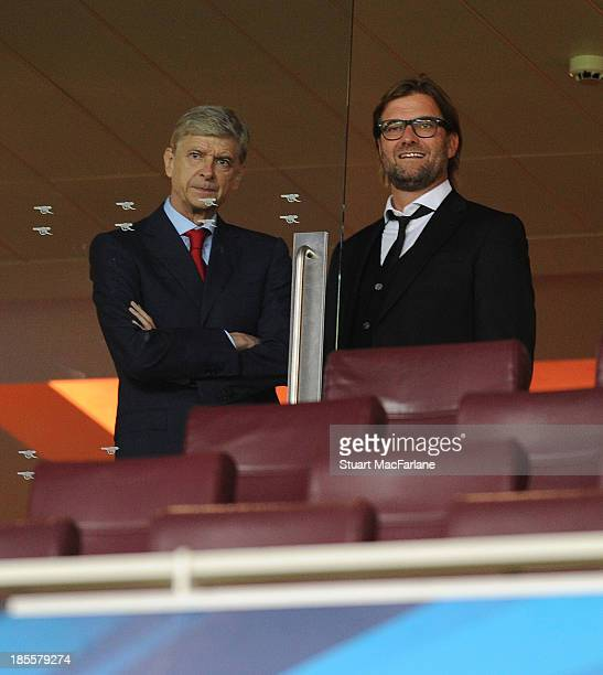 Arsenal manager Arsene Wenger with Dortmund Head Coach Jurgen Klopp in the Directors box ahead of the UEFA Champions League Group F match between...