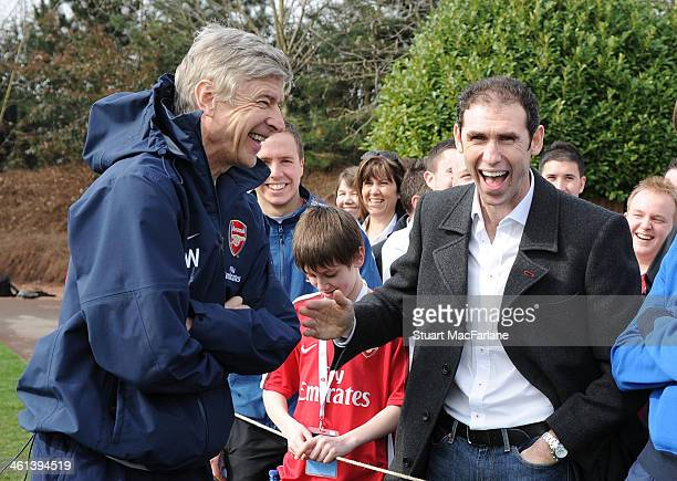 Arsenal manager Arsene Wenger with ex player Martin Keown at the Arsenal Training Ground on March 18 2010 in London England