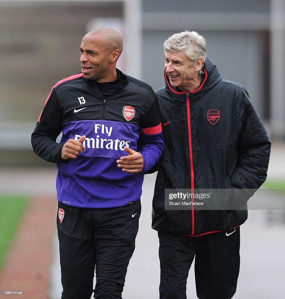 Arsenal manager <a gi-track='captionPersonalityLinkClicked' href=/galleries/search?phrase=Arsene+Wenger&family=editorial&specificpeople=171184 ng-click='$event.stopPropagation()'>Arsene Wenger</a> with ex player <a gi-track='captionPersonalityLinkClicked' href=/galleries/search?phrase=Thierry+Henry&family=editorial&specificpeople=167275 ng-click='$event.stopPropagation()'>Thierry Henry</a> before a training session at London Colney on December 28, 2012 in St Albans, England.