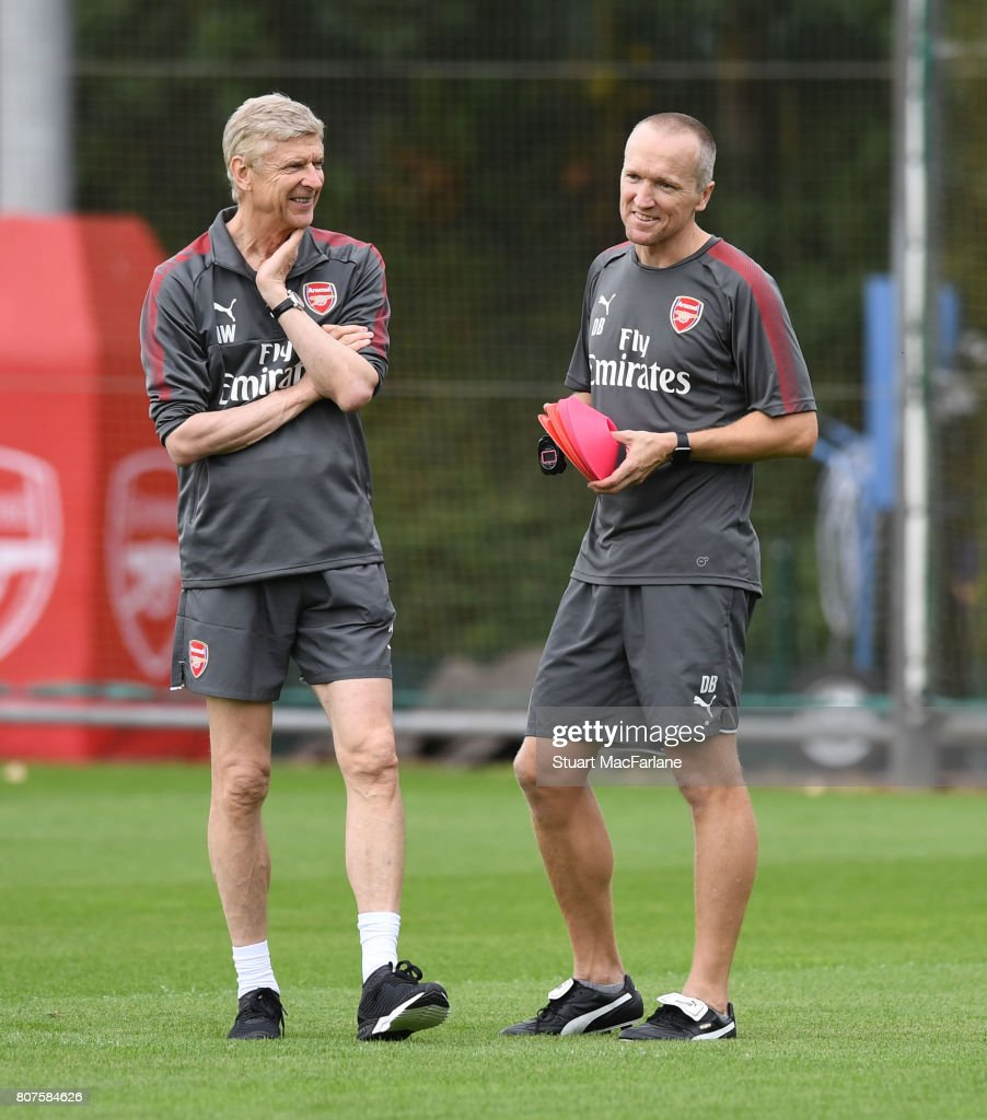 Arsenal manager Arsene Wenger with Fitness coach Darren Burgess during a training session at London Colney on July 4, 2017 in St Albans, England.
