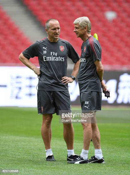 Arsenal manager Arsene Wenger with fitness coach Darren Burgess during a training session at the Birds Nest stadium on July 21 2017 in Beijing China