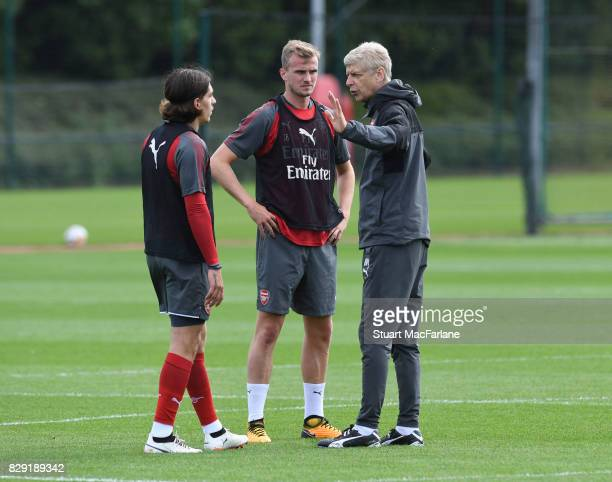 Arsenal manager Arsene Wenger with Hector Bellerin and Rob Holding during a training session at London Colney on August 10 2017 in St Albans England