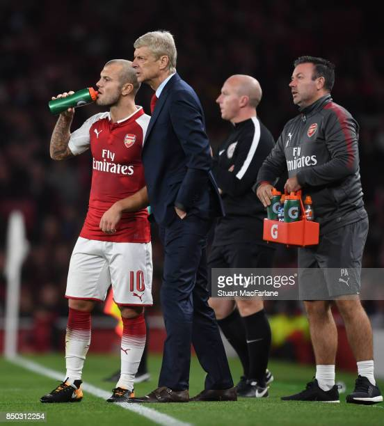 Arsenal manager Arsene Wenger with midfielder Jack Wilshere during the Carabao Cup Third Round match between Arsenal and Doncaster Rovers at Emirates...