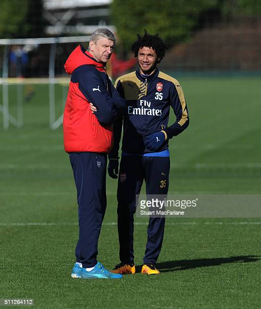 Arsenal manager Arsene Wenger with Mohamed Elneny during a training session at London Colney on February 19 2016 in St Albans England