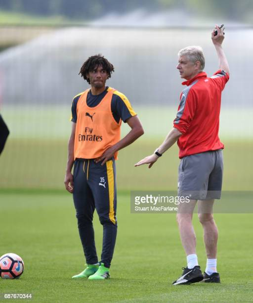 Arsenal manager Arsene Wenger with Mohamed Elneny during a training session at London Colney on May 24 2017 in St Albans England
