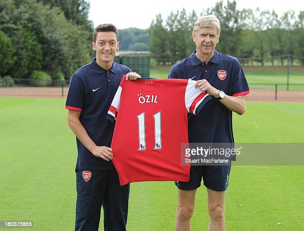 Arsenal manager Arsene Wenger with new signing Mesut Oezil at London Colney on September 12 2013 in St Albans England