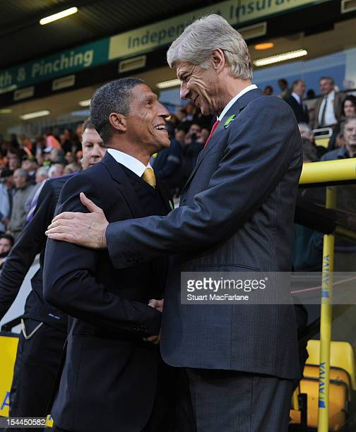Arsenal manager Arsene Wenger with Norwich manager Chris Hughton before the Barclays Premier League match between Norwich City and Arsenal at Carrow...