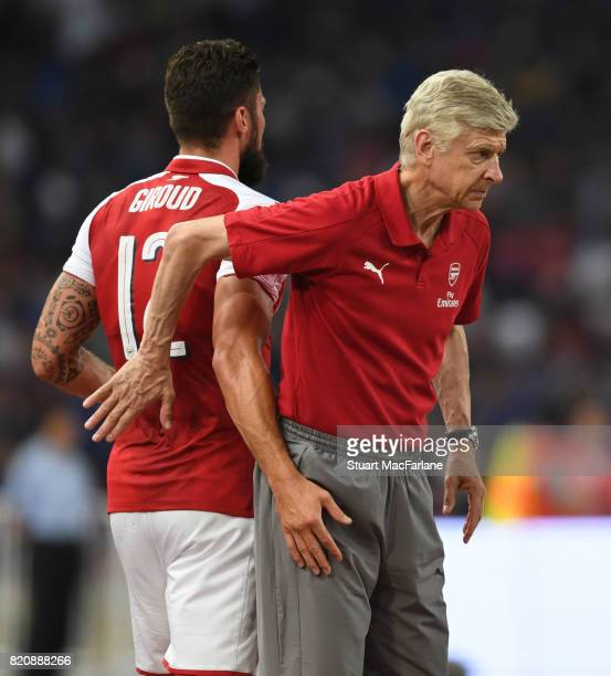 Arsenal manager Arsene Wenger with Olivier Giroud during the pre season friendly between Arsenal and Chelsea at the Birds Nest on July 22 2017 in...