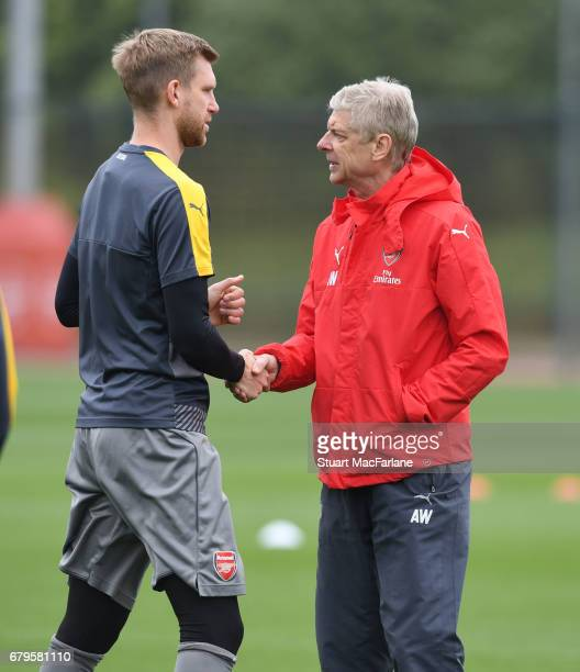 Arsenal manager Arsene Wenger with Per Mertesacker before a training session at London Colney on May 6 2017 in St Albans England