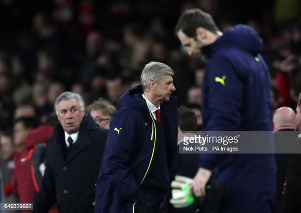 Arsenal manager Arsene Wenger with Petr Cech and Bayern Munich manager Carlo Ancelotti during the UEFA Champions League Round of 16 Second Leg match...