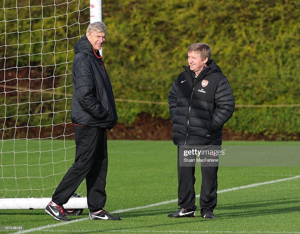 Arsenal manager Arsene Wenger with reserve team coach Terry Burton during a training session at London Colney on December 03, 2012 in St Albans, England.