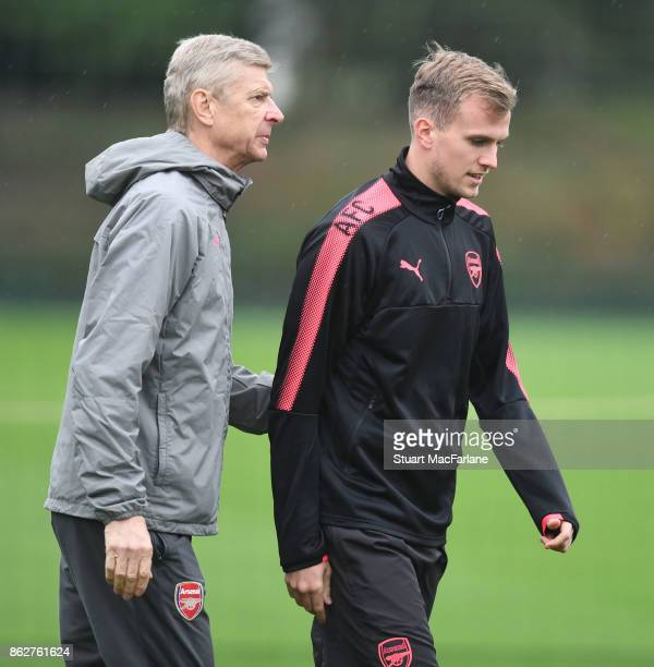 Arsenal manager Arsene Wenger with Rob Holding before a training session at London Colney on October 18 2017 in St Albans England