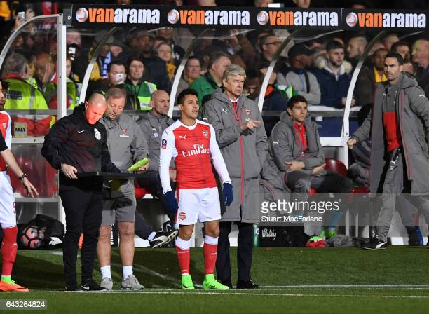 Arsenal manager Arsene Wenger with substitute Alexis Sanchez during the Emirates FA Cup Fifth Round match between Sutton United and Arsenal on...