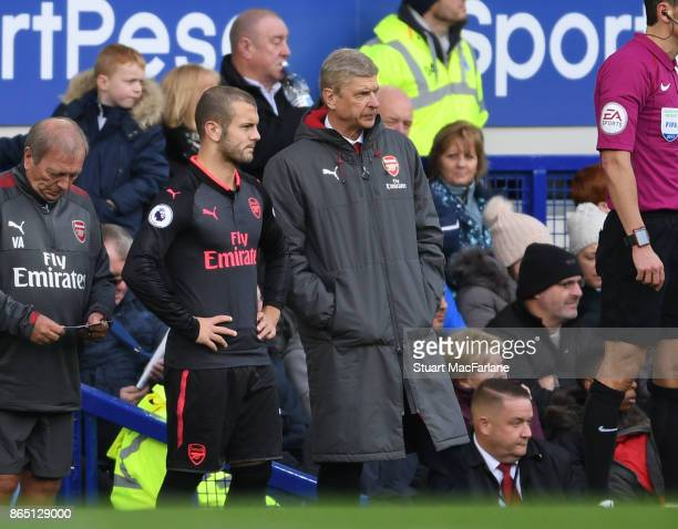 Arsenal manager Arsene Wenger with substitute Jack Wilshere during the Premier League match between Everton and Arsenal at Goodison Park on October...
