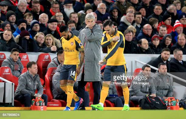 Arsenal manager Arsene Wenger with substitutes Arsenal's Theo Walcott and Arsenal's Lucas Perez during the Premier League match at Anfield Liverpool