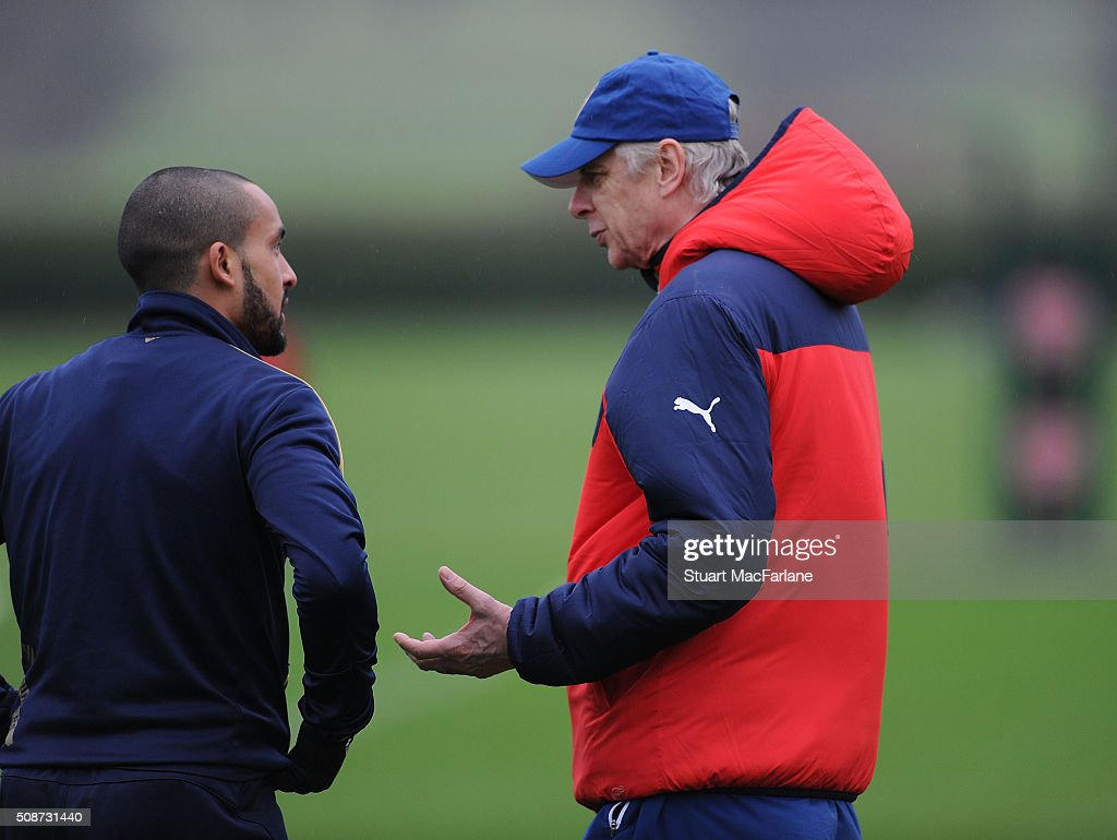 Arsenal manager Arsene Wenger with Theo Walcott during a training session at London Colney on February 6, 2016 in St Albans, England.