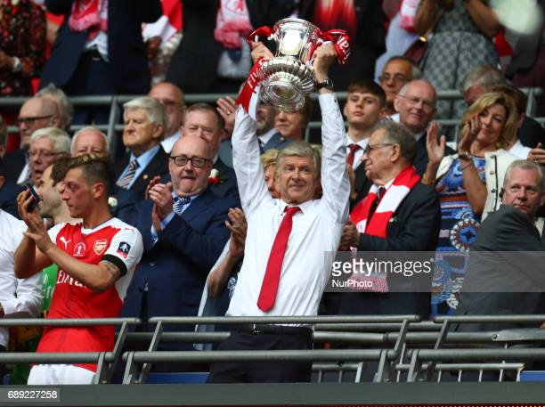 Arsenal manager Arsene Wenger with Trophy during The Emirates FA Cup Final between Arsenal against Chelsea at Wembley Stadium on May 27 2017 England