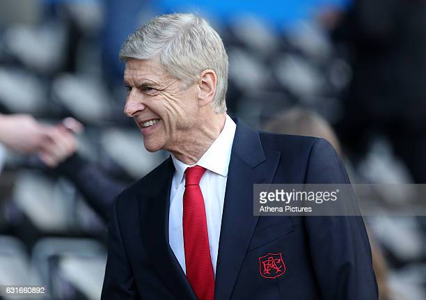Arsenal Manager Arsène Wenger smiles prior to kick off of the Premier League match between Swansea City and Arsenal at The Liberty Stadium on January...
