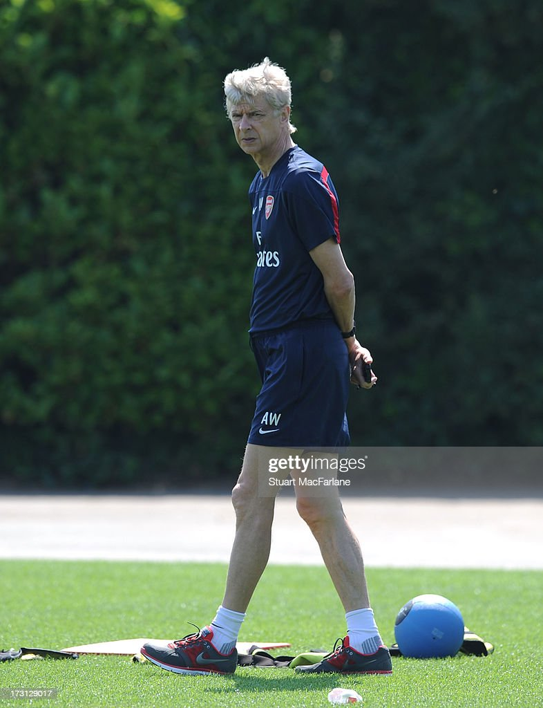 Arsenal manager Arsnene Wenger looks on during a training session at London Colney on July 08, 2013 in St Albans, England.